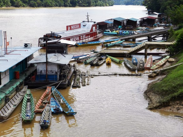 Fishing boats tied up at a small harbour in Kanowit, Sarawak, Borneo.