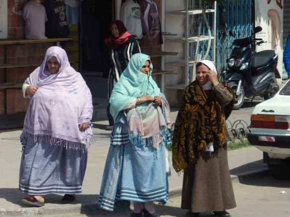 Women in traditional dress in the modern part of Tataouine, Tunisia.