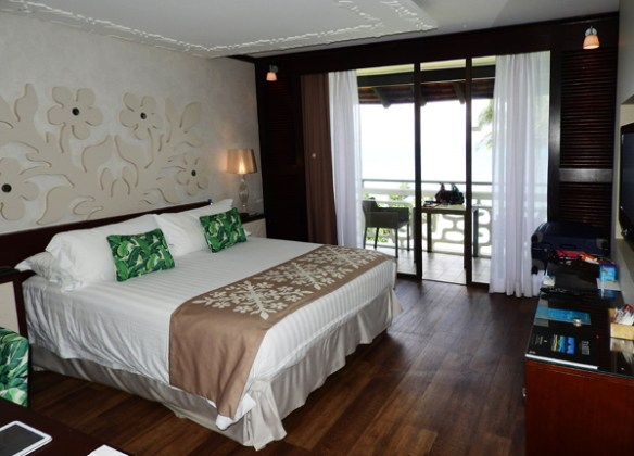 Our superior lagoon view room with king-size bed and balcony at the Tahiti Intercontinental Hotel.