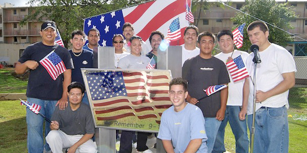Students Standing In Front Of Flag