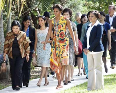 Group of first ladies walking on sidewalk