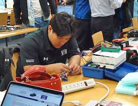 Male student working on micro robot