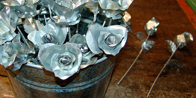 A bucket of sheet metal roses
