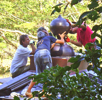 people putting sculpture on rood