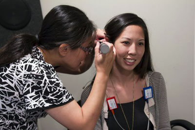 Chiemi Tanaka demonstrates an exam at the JABSOM CSD Speech-Hearing Clinic