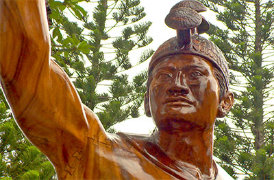 The warrior statue was hand carved by master carver Tuione Pulotu.