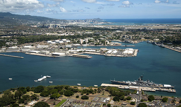 An aerial view of the USS Arizona and USS Missouri Memorials at Ford Island, Joint Base Pearl Harbor