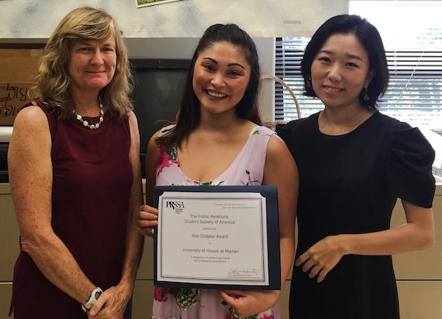 three women with award