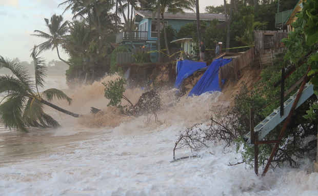 Coastal home at risk from coastal erosion and high surf