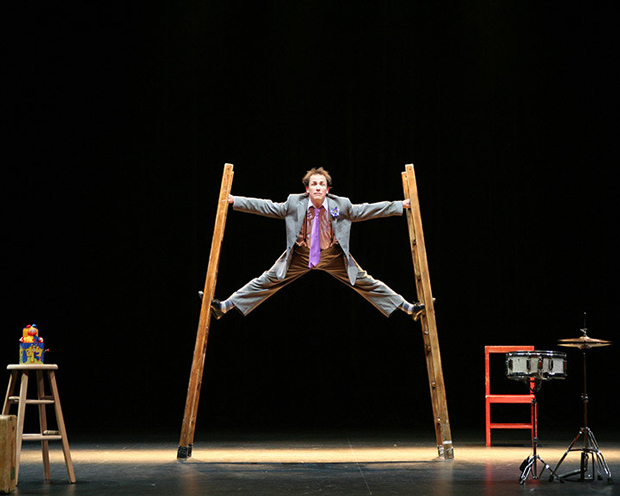 actor performing on ladder