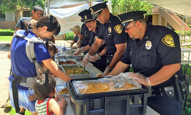 Honolulu Police Department officers serving meals