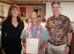 Kapiʻolani Community College's David Apostol, center, is presented his award by, Board of Regents Chair Jan Sullivan and UH President David Lassner.