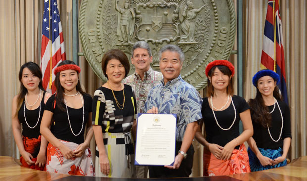 group of people holding proclamation in the Hawaii governor's office