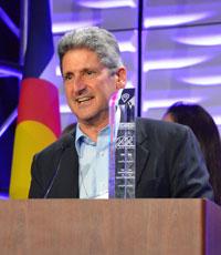 David Lassner at a podium accepting an award