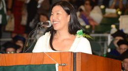 Ai-Jen Poo speaking at a podium