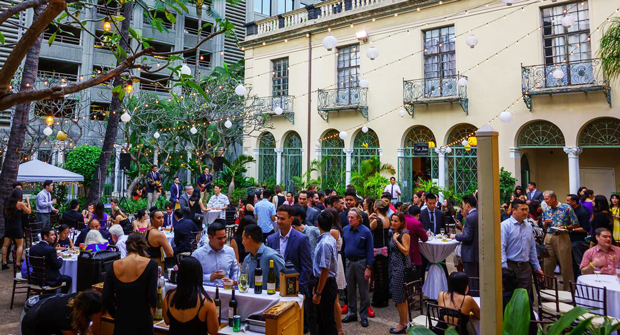 group of people dining and mingling in front of a building