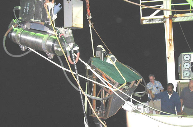 The Proof Module being lowered from a ship