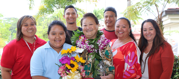 Recipient Janet Lindsey (center) stands with family and staff