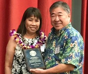 Beverly Suemoto receiving award
