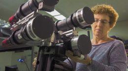 Habbal examining telescope and cameras