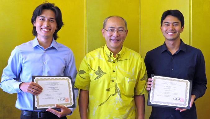 Yasushi Misawa presenting DeLang and Yasumori with certificates