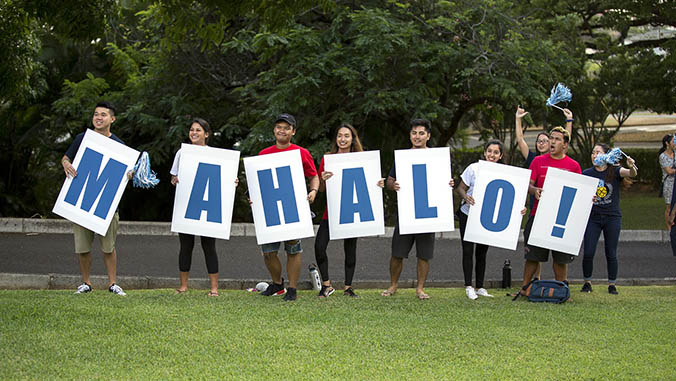 "Students holding letter signs that spell ""MAHALO"""