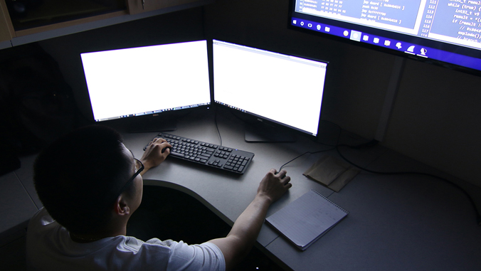Student working on a double monitor