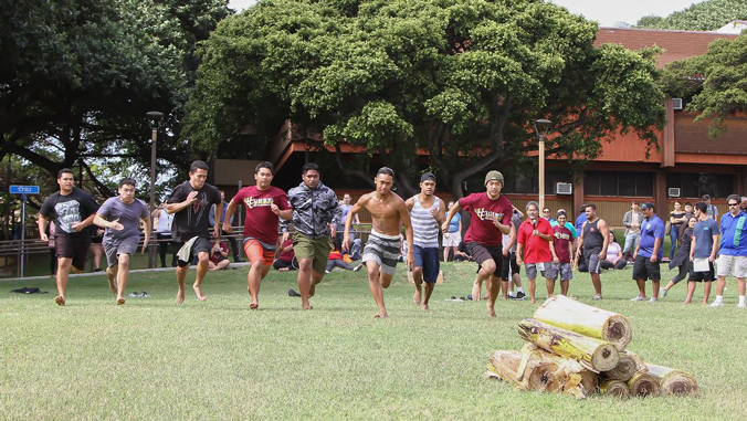 Young men participating in Makahiki games
