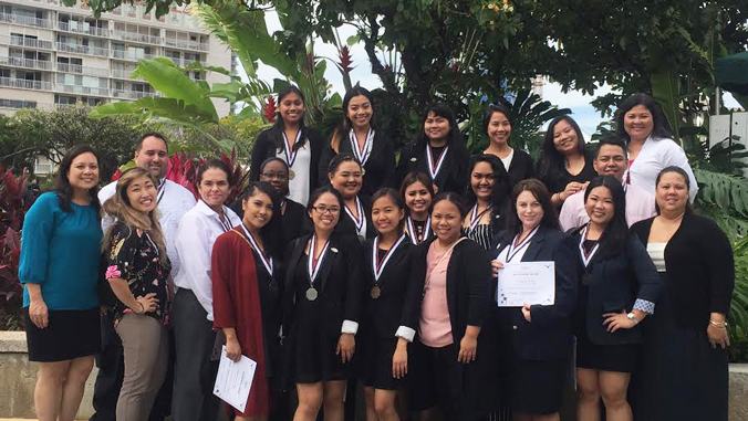 Kapiolani C C students holding H O S A awards