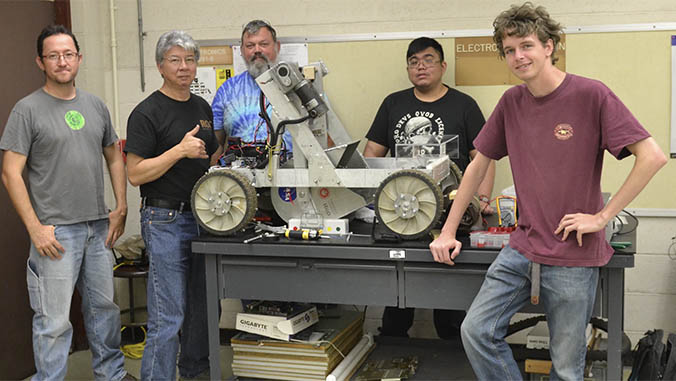 Instructors and students with finished electronics project