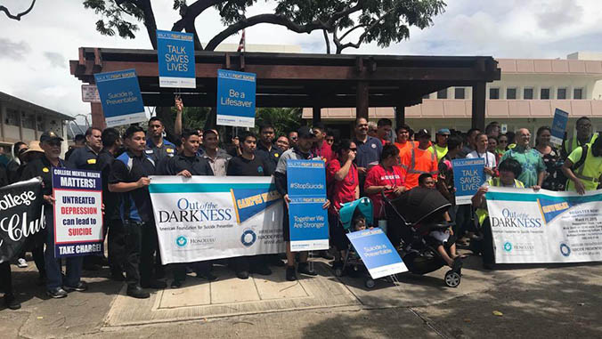 Honolulu community college ohana with signs