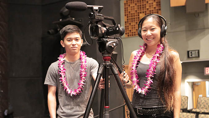 Two students with a camera