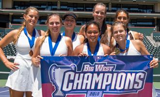 women's tennis team holding championship banner