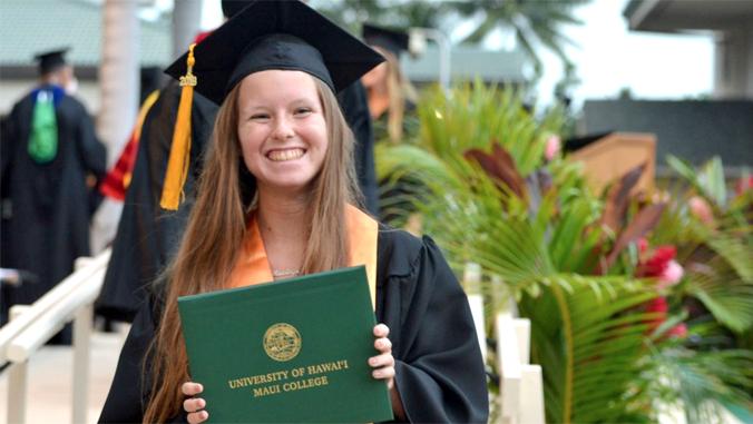 Hendricks holding her diploma