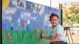 girl taking pollinator pledge