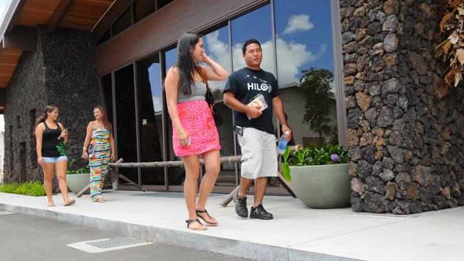 4 students walking at the Hawaii C C Palamanui campus