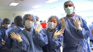medical students wearing scrubs and gloves