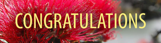 The word 'congratulations' in front of a flower