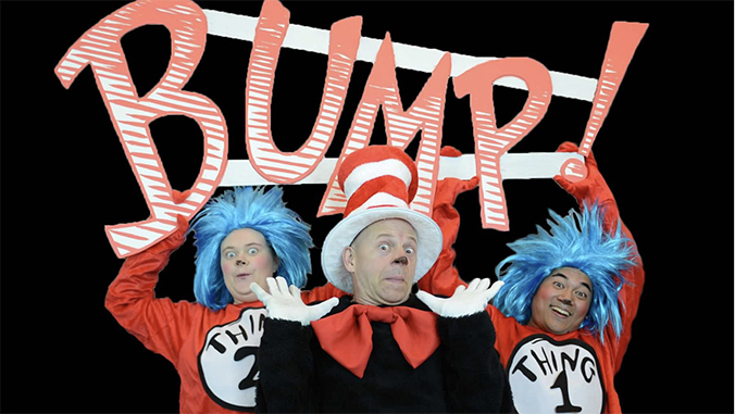 Actors dressed as Thing One, Thing Two and The Cat in the Hat