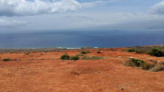 Kahoolawe island coastline with island of Maui in the distance