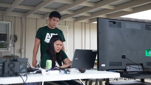 Two students working at a computer, click for larger image