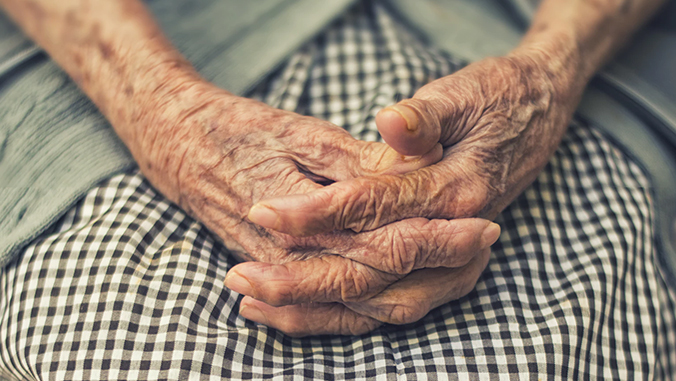 Clasped hands of an elderly person