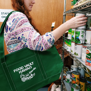 woman grabbing canned food from shelf
