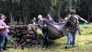 students hauling large debris