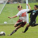 former student playing soccer