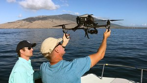 Researchers releasing a drone