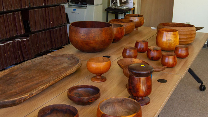 Hawaiian bowls and artifacts on a table