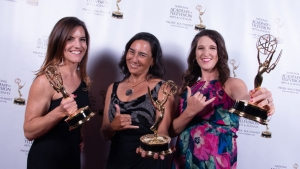 Three women holding Emmy awards, click for larger image