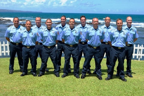 Members of the Hawaii Fire Department's 38th Fire Fighter Recruit Class pose for a class photo. From left to right: Jared Spencer, Jason Habu, Jeffrey Maki, Waylen Towata, Christopher Olayon, Damien-Joseph Wengler-Ioane, West Hawthorne, Andrew Miller, Tyler Nagamine, Roland Laliberte, and Paul Higgins