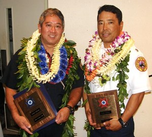 Officer of the Year Lloyd Ishikawa and Firefighter of the Year Lance Uchida display their plaques.